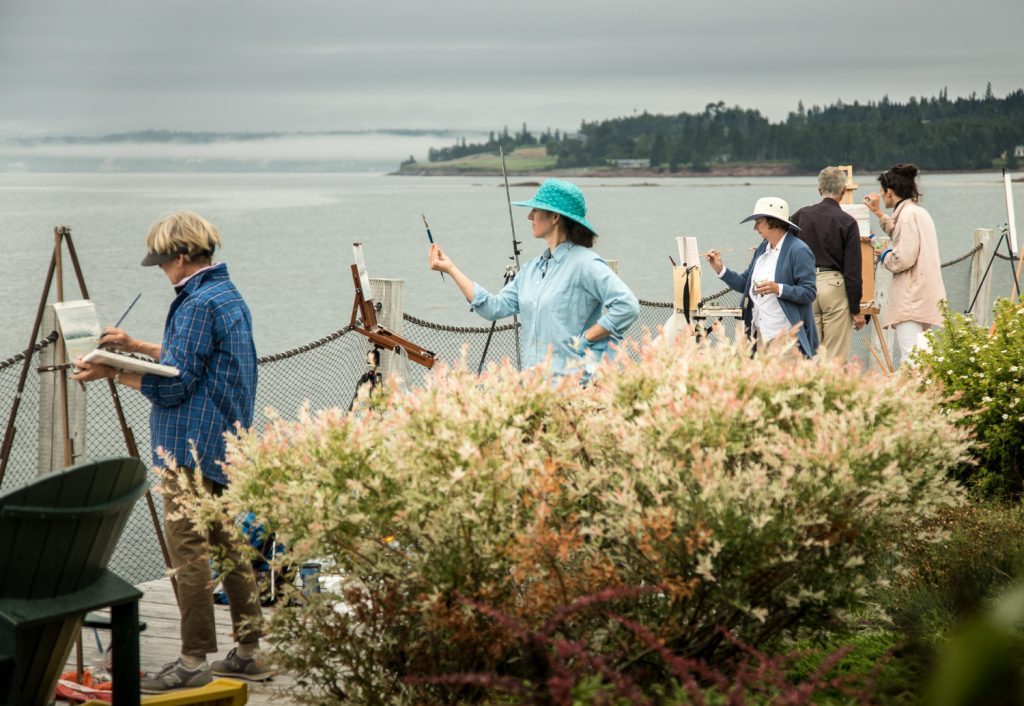 People painting along the windswept shores of Passamaquoddy Bay