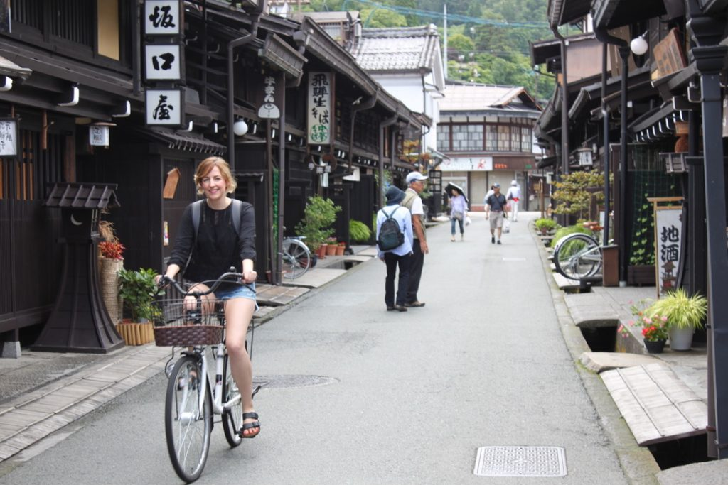 A girl cycling through Sanmachi Suji