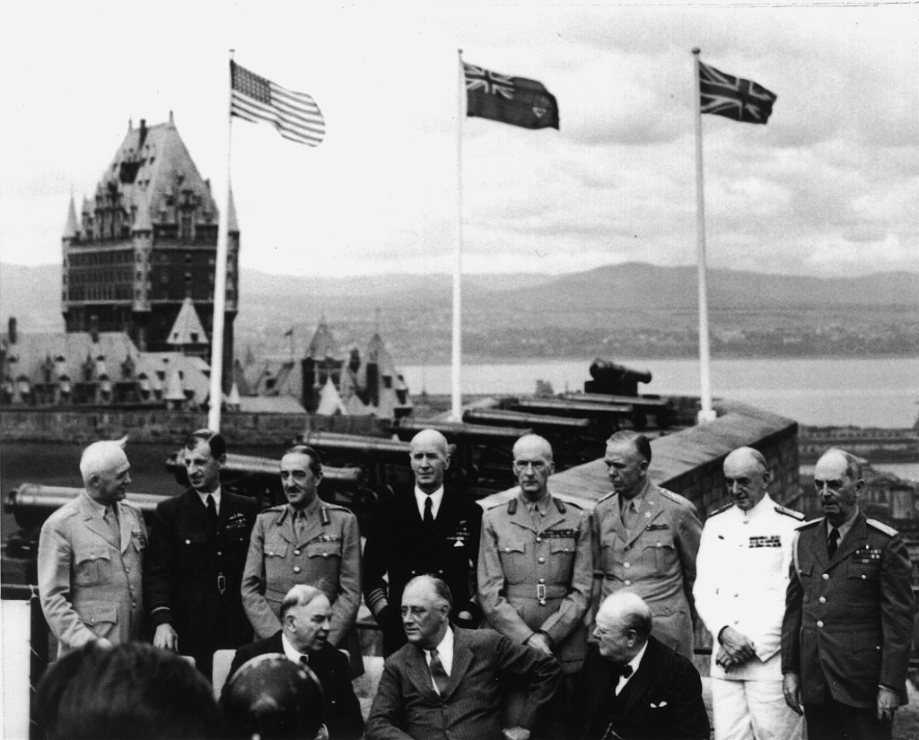 Mackenzie King, Franklin D. Roosevelt and Winston Churchill (front, left to right) with their generals and admirals at the first Quebec Conference at the Château Frontenac, August 1943.