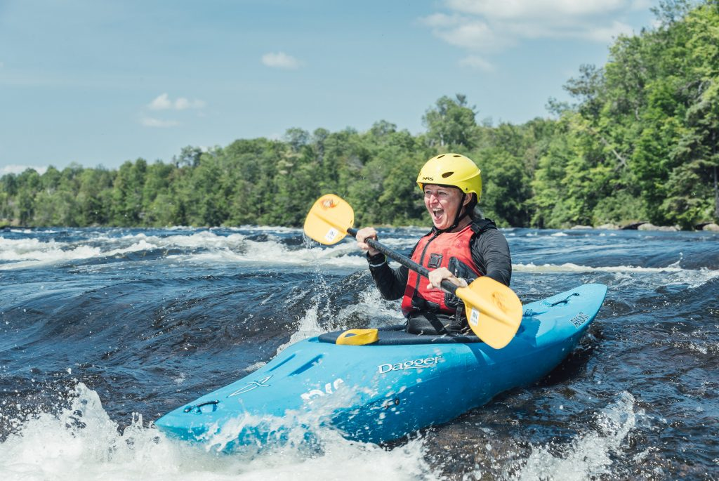 Woman kayaking on whitewater