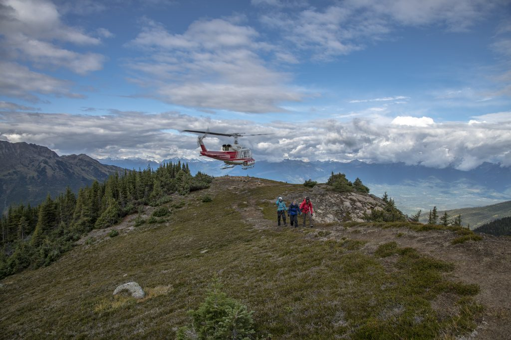 Helicopter dropping off hikers atop the mountain
