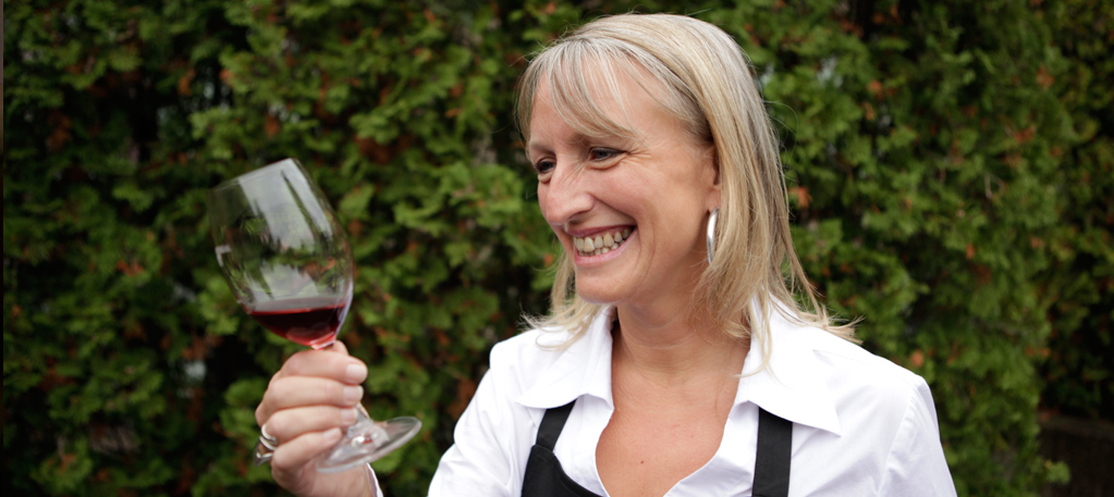 Veronique Rivest holding a glass of red wine