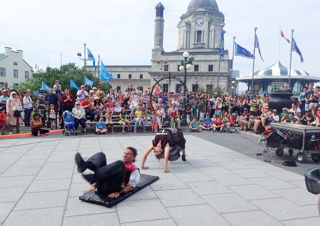 Buskers performing in a square in Quebec City