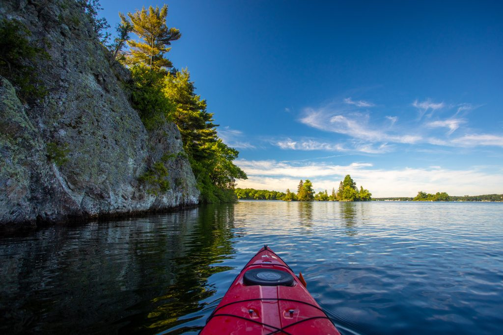 A red kayak in the St. Lawrence River