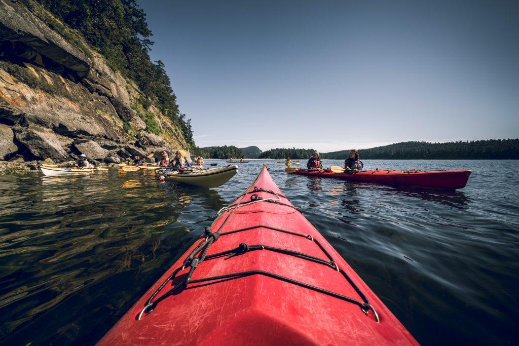 Red kayaks, kayaker POV