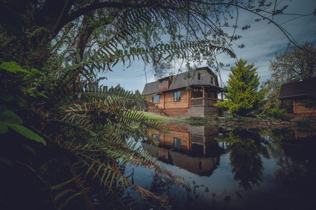Log cabin on pond