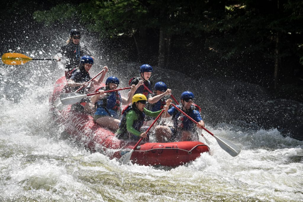 A group of people whitewater rafting in New Hampshire