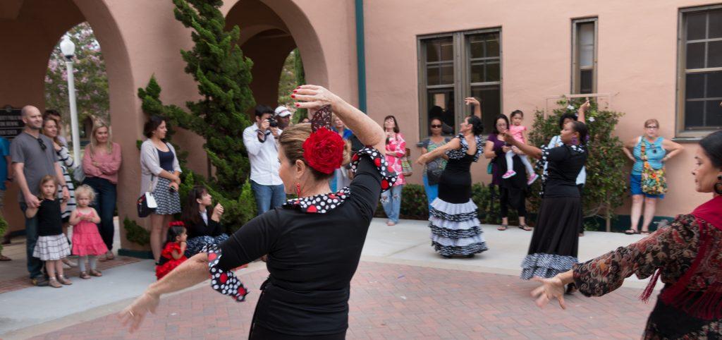 Flamenco dancers in a courtyard