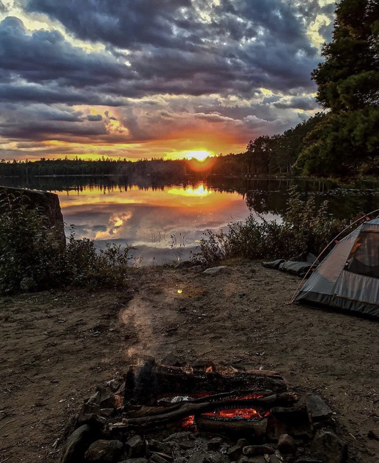 Sunsets over a lakeside campside