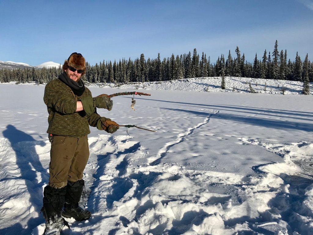 Man ice fishing in Yukon