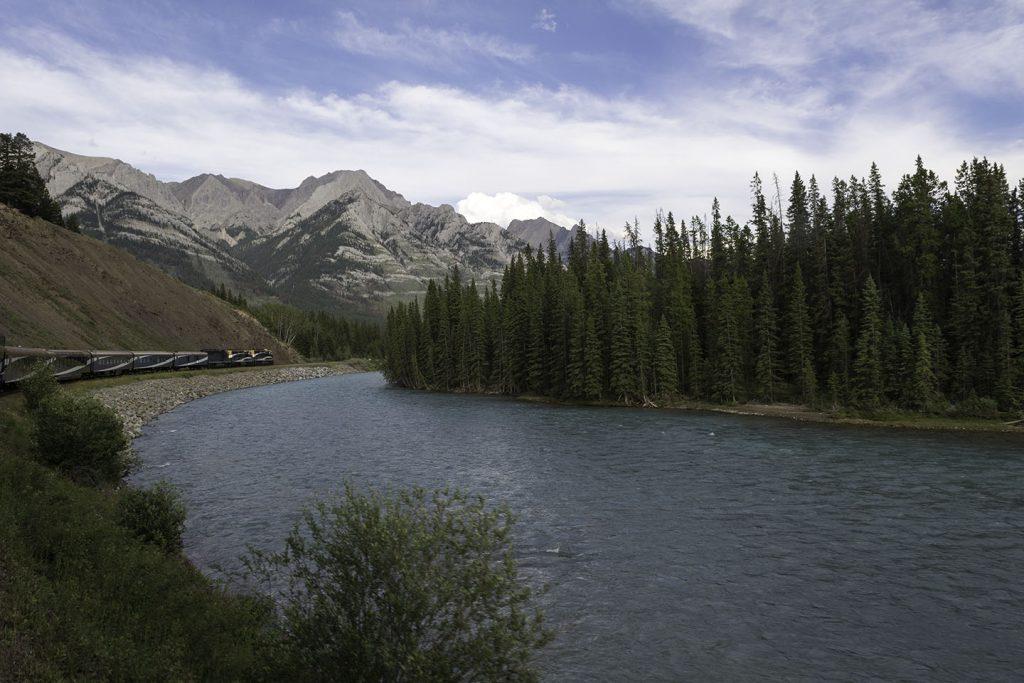 A mountain overlooks a lake