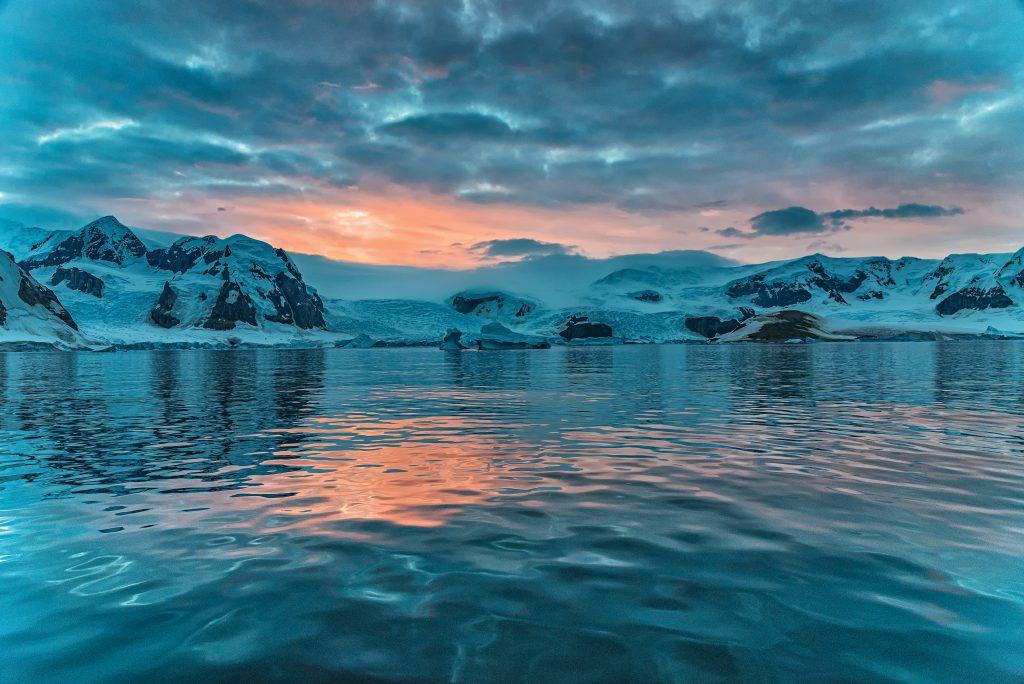 sun rises over arctic landscape