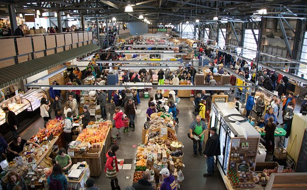 A farmers market in an industrial space