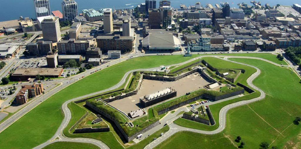A star shaped citadel sits atop a green hill in the middle of downtown Halifax