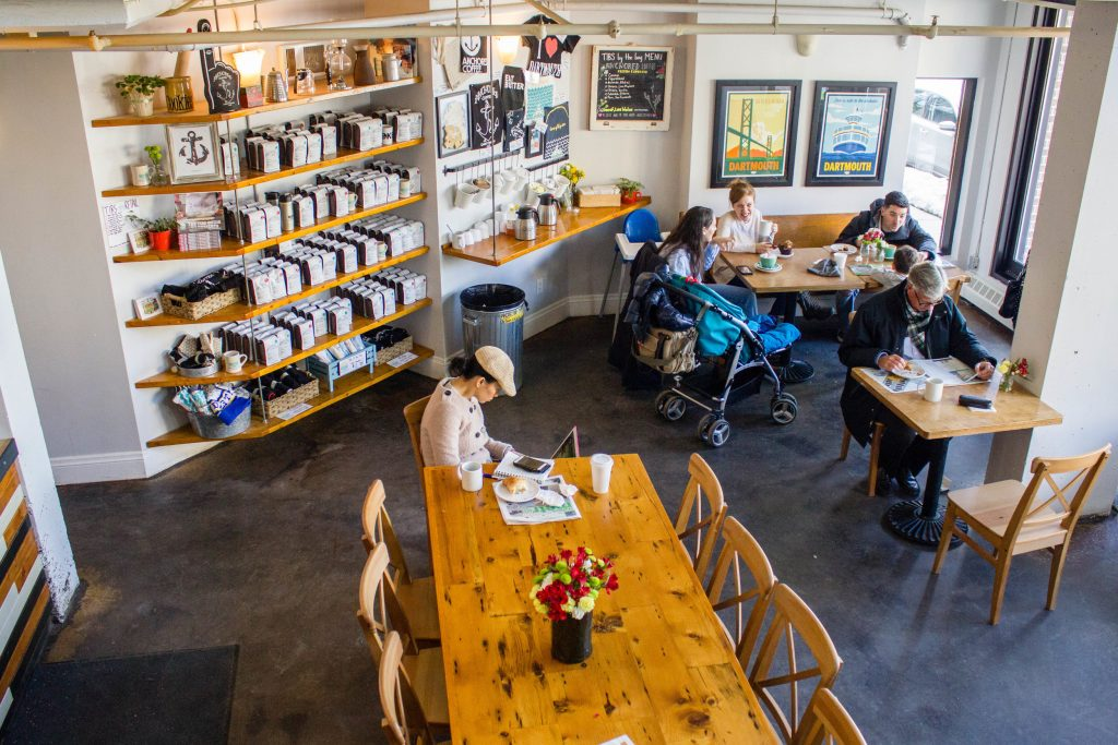An overhead photo looks over a cafe with wooden tables