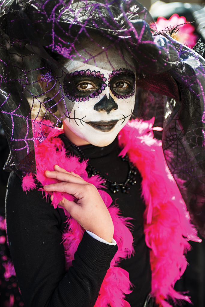 A young girl in costume during the Day of the Dead festival.