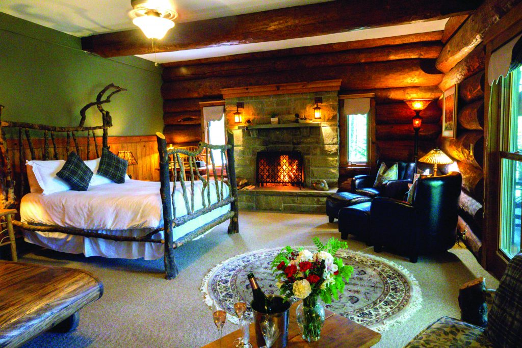 A fire-lit bedroom in a luxurious lodge
