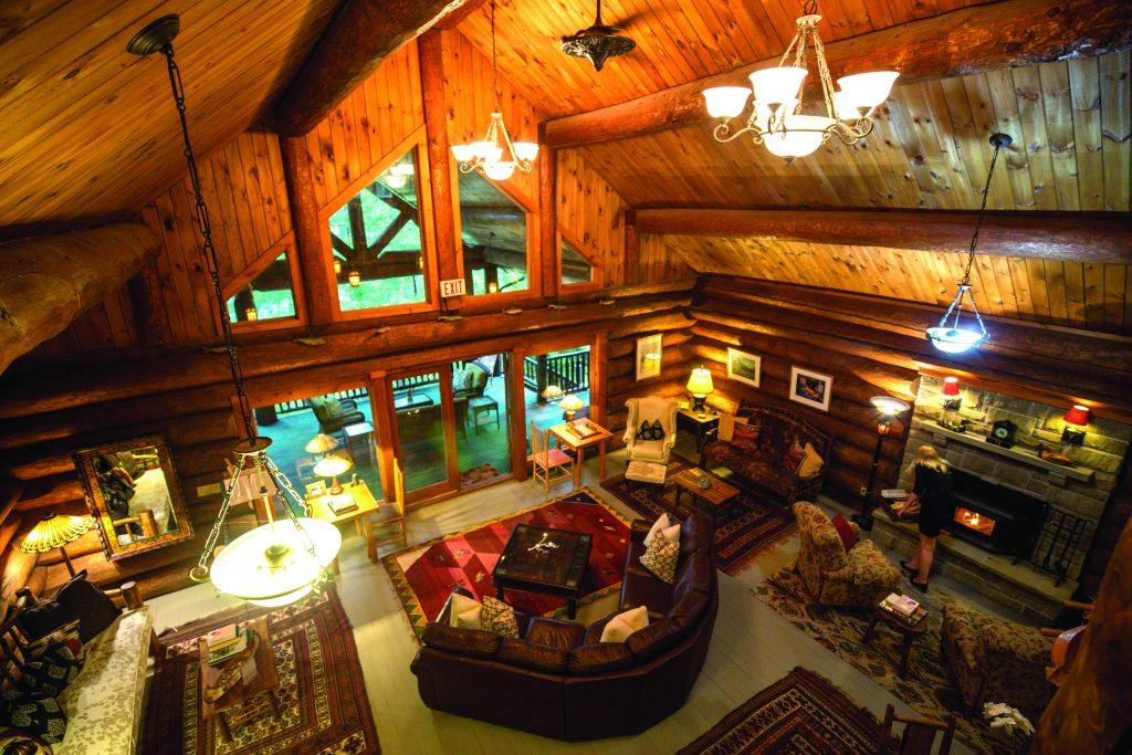 Cozy, rustic and luxurious living room with high wooden ceilings and beams