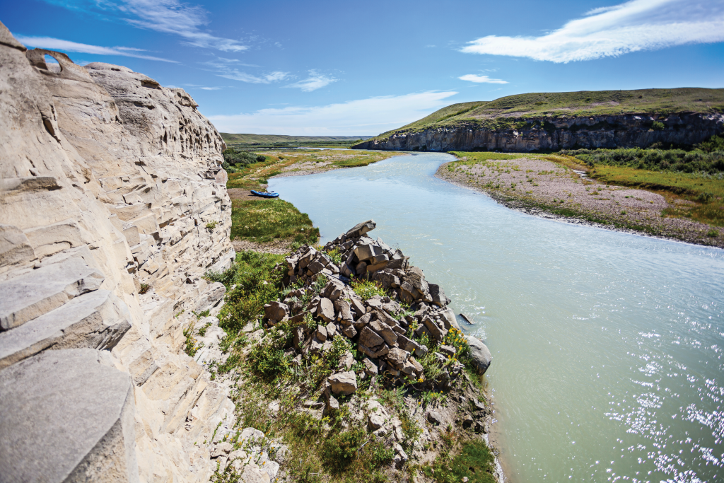 River flows past sandstone walls