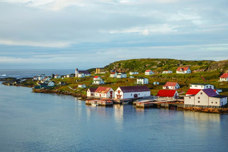 Golden light from the evening sun shines upon the historic community of Battle Harbour, Labrador.