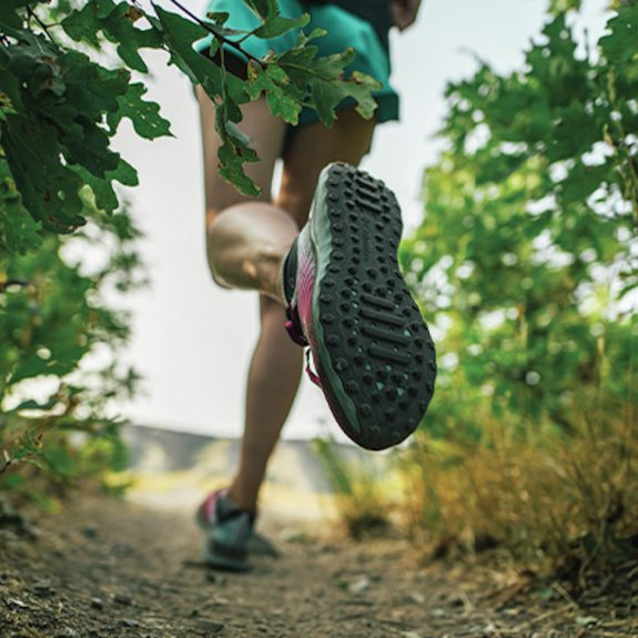 A runner wearing AdaptTrax shoes by Columbia