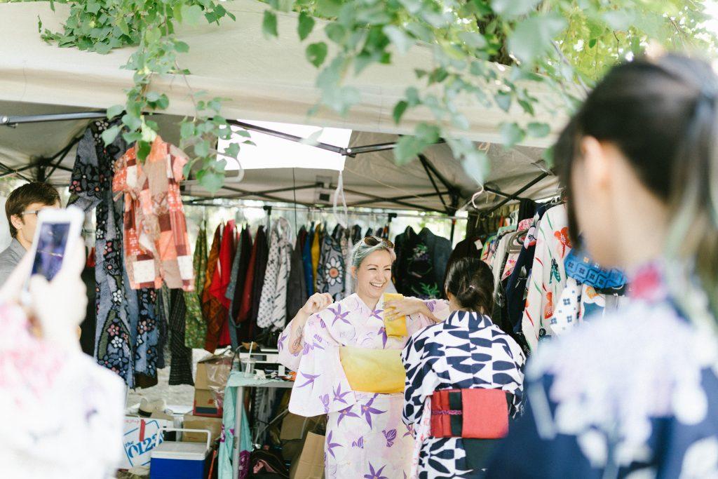 A woman tries on a kimono at yatai fest