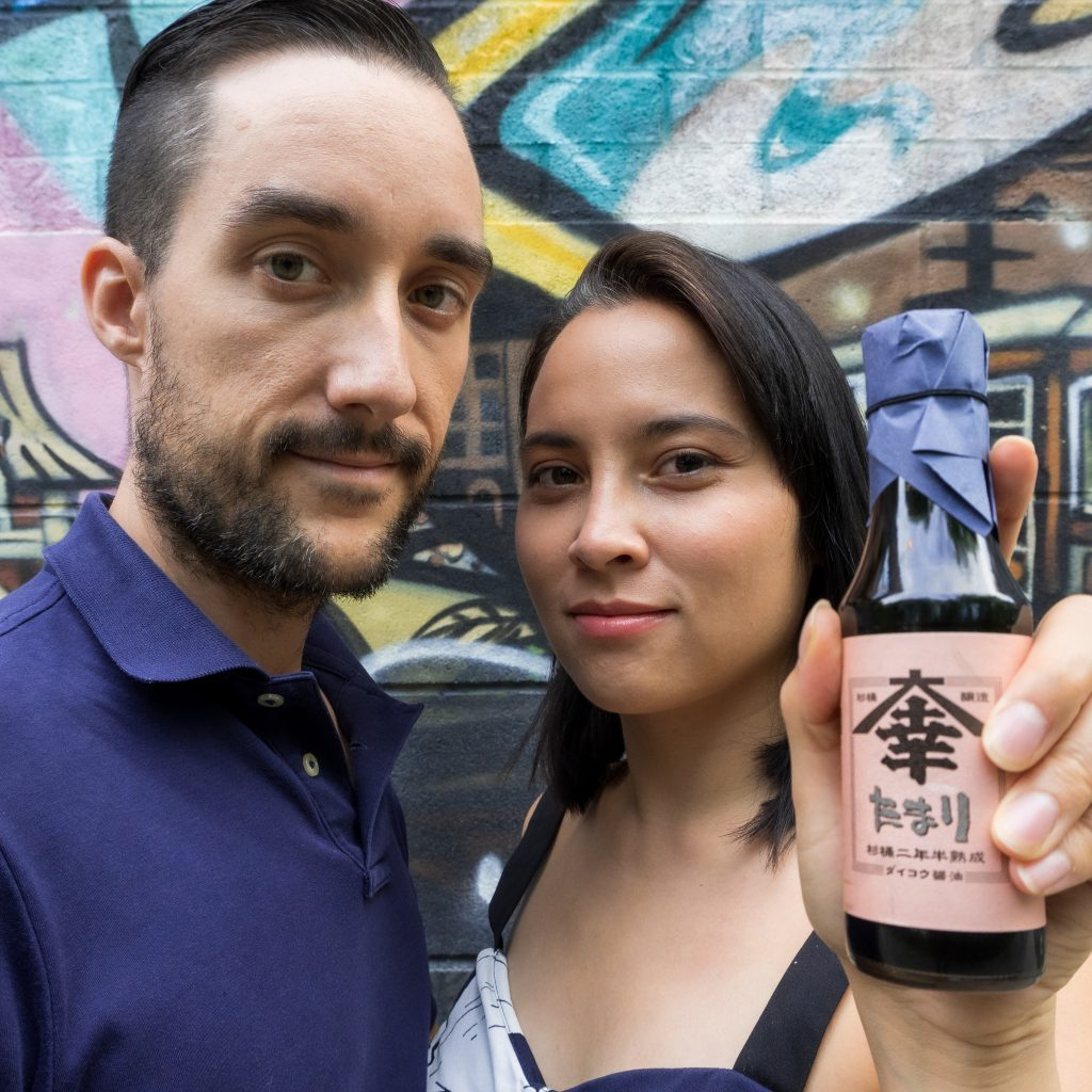 Tokusen founders holding soy sauce product