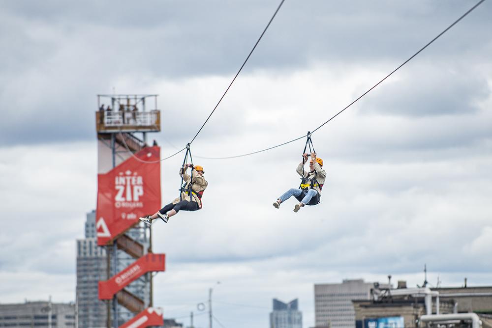two people zipline between ontario and quebec